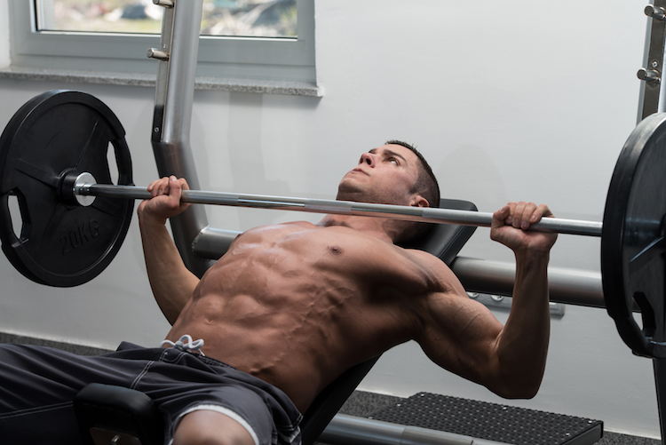 Man In Gym Exercising Chest On The Bench Press